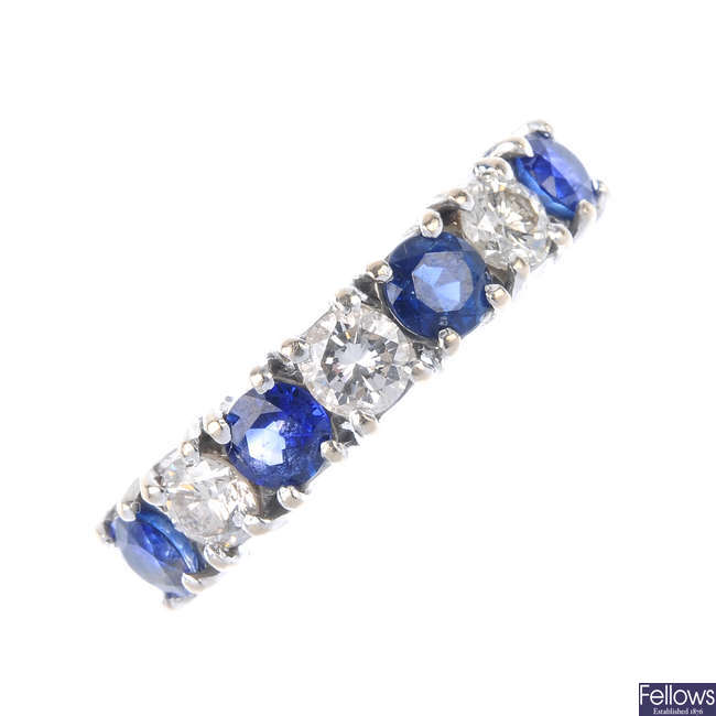 An 18ct gold sapphire and diamond band ring.