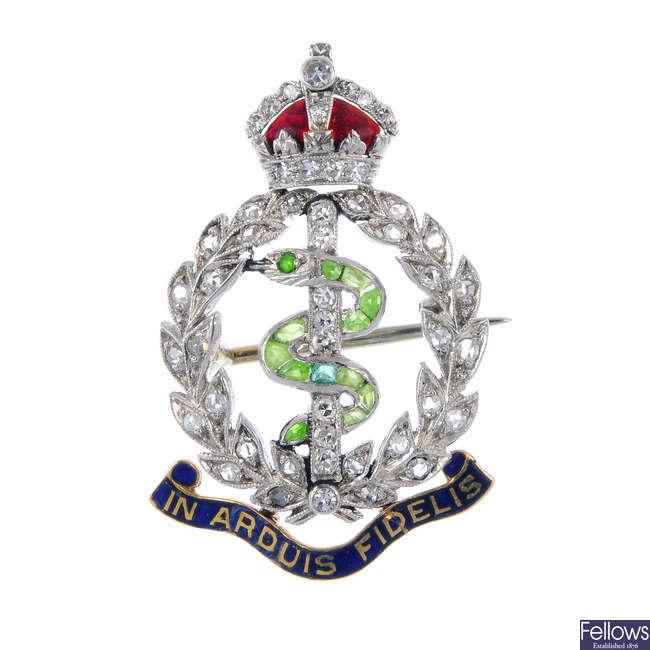 An early 20th century diamond, gem-set and enamel regimental brooch.