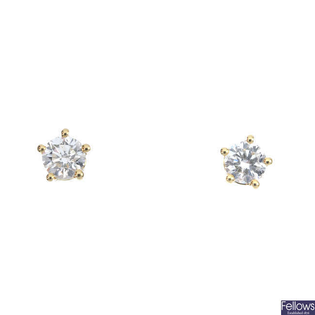 A pair of brilliant-cut diamond ear studs.