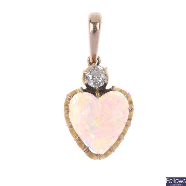 A mid 20th century opal and diamond pendant.