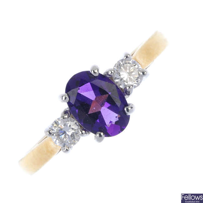 An 18ct gold amethyst and diamond three-stone ring.