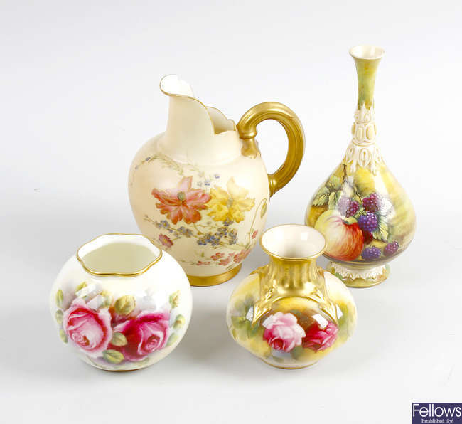 A group of four various Royal Worcester vases.