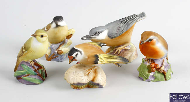 Five Royal Worcester bone china models of birds.