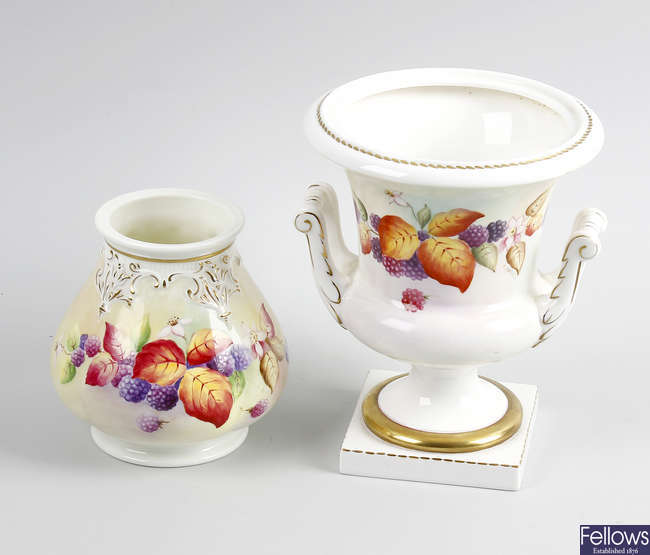Two porcelain vases, by Florence Harvey, etc.