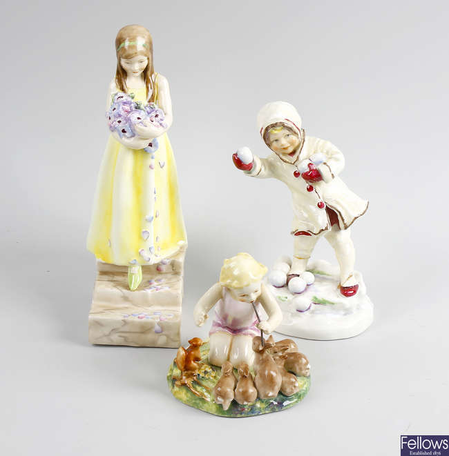 A group of four Royal Worcester figures, plus another.