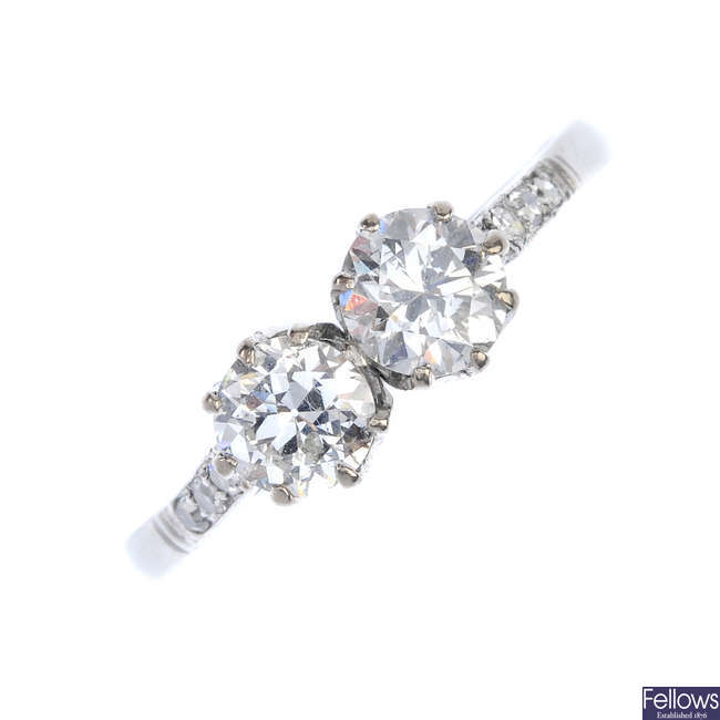 A diamond two-stone ring.