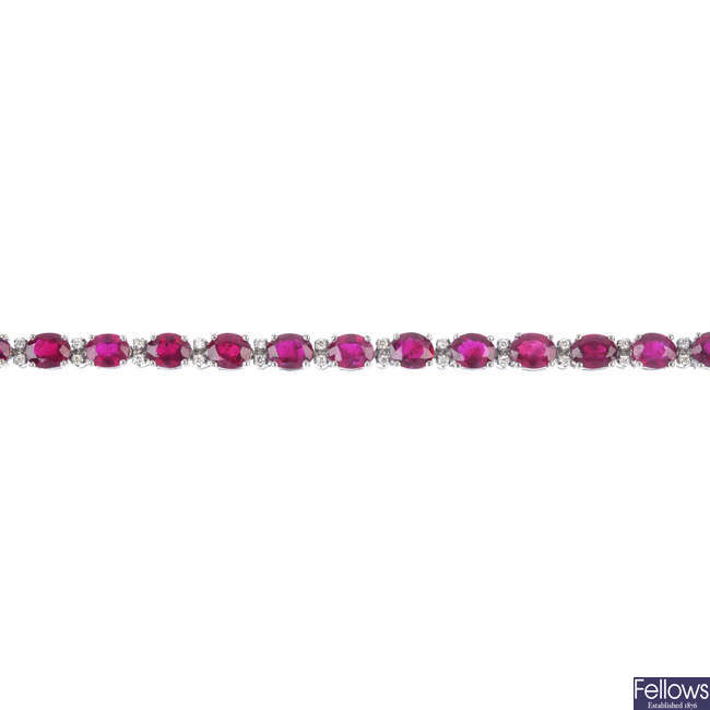 An 18ct gold ruby and diamond line bracelet.