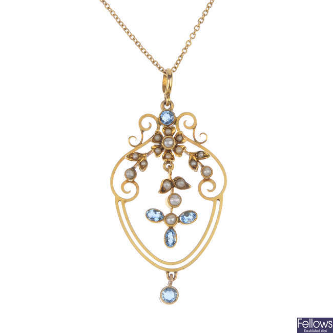 An early 20th century 9ct gold aquamarine and split pearl pendant.