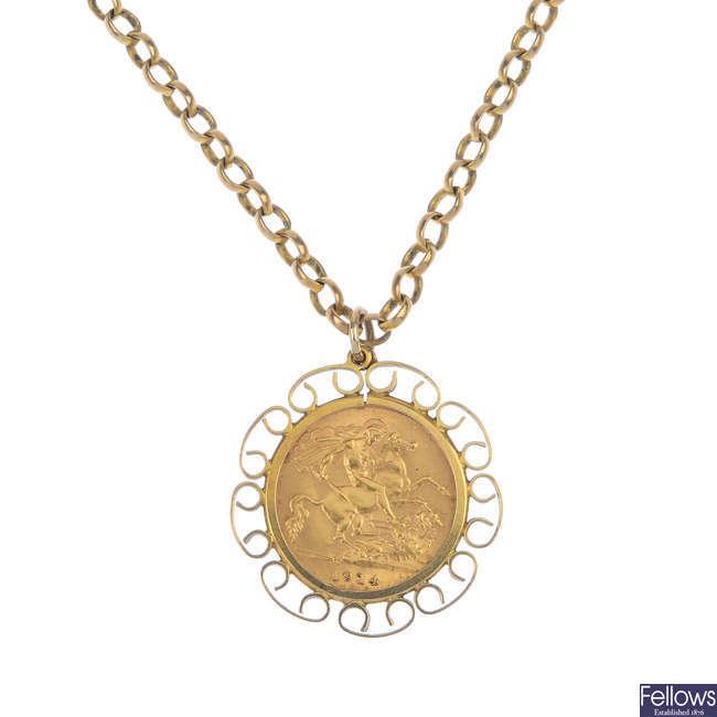 A half-sovereign pendant.