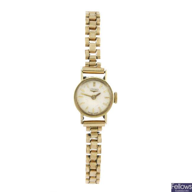 LONGINES - a lady's yellow metal bracelet watch.