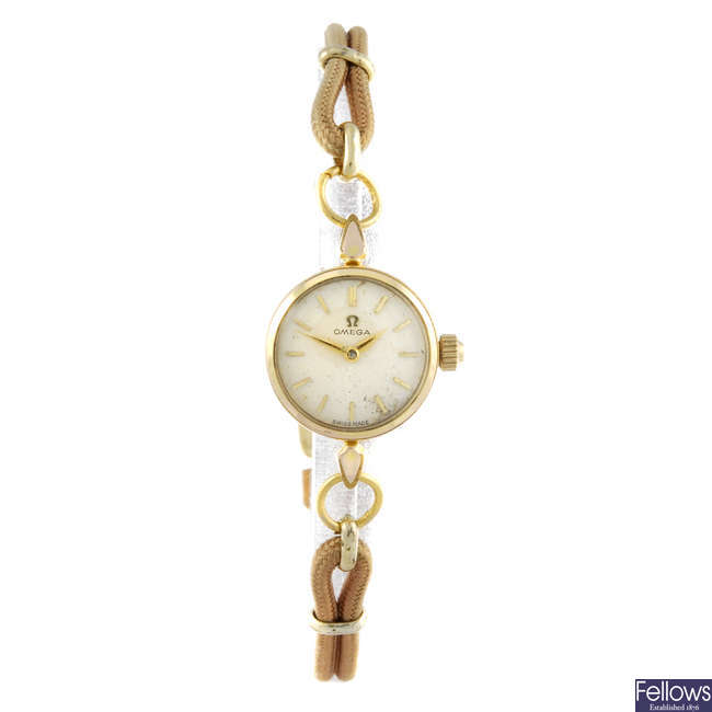 OMEGA - a lady's gold plated wrist watch.