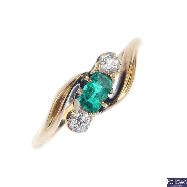 An early 20th century 18ct gold emerald and diamond three-stone ring.