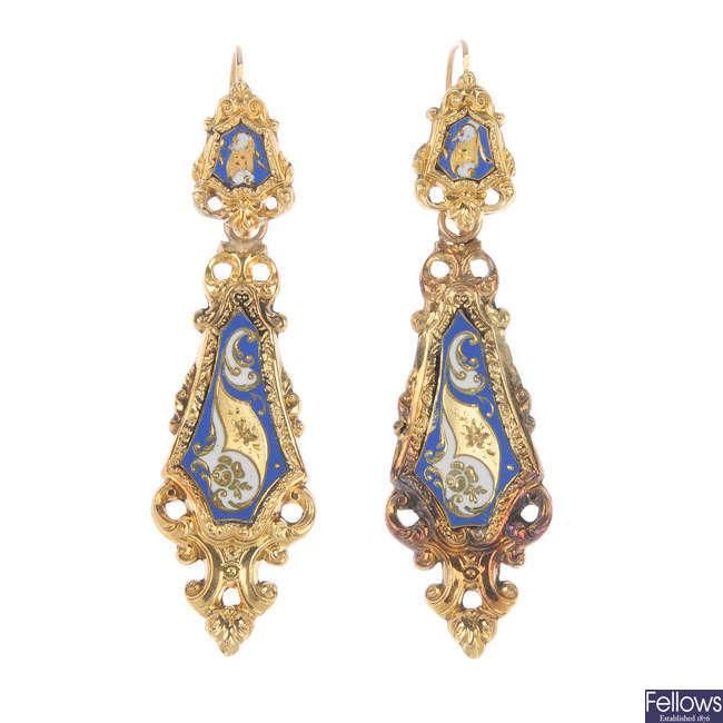 A pair of late 19th century enamel ear pendants.