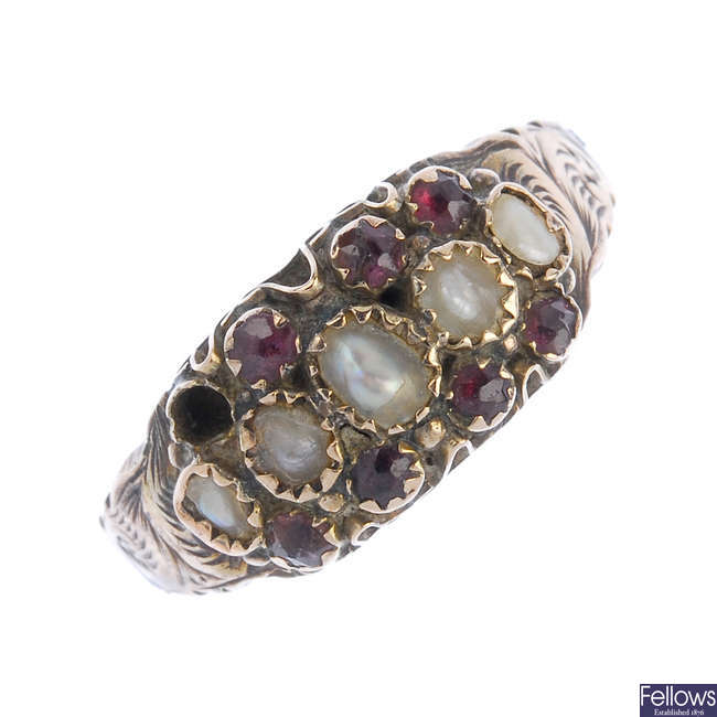 A late Victorian 9ct gold garnet and split pearl ring.