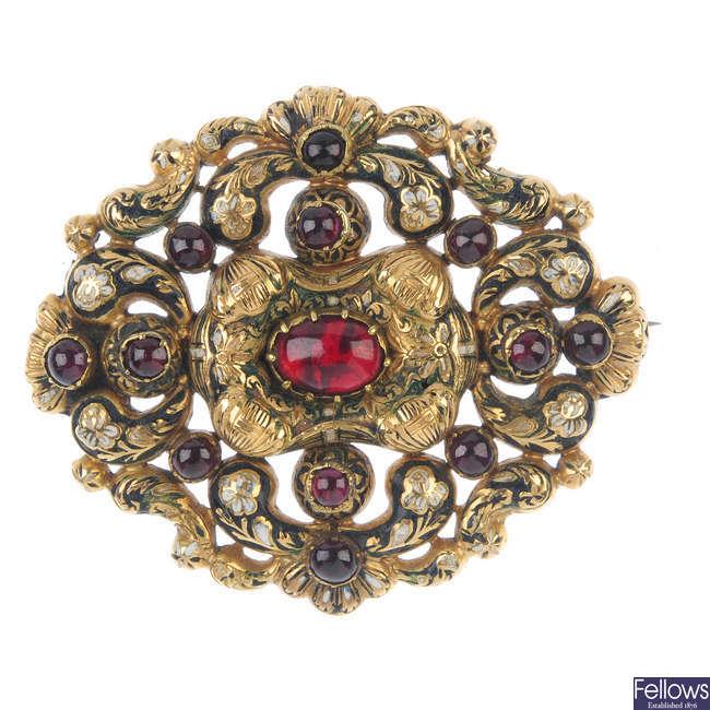 A mid 19th century gold garnet and enamel brooch.