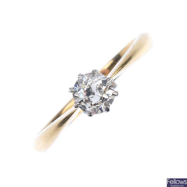 An interchangeable diamond single-stone ring, stickpin and stud.