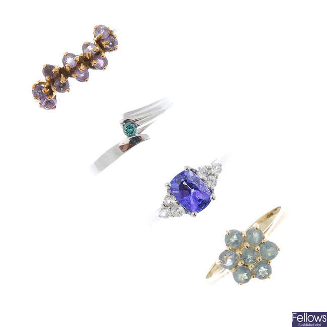A selection of four 9ct gold gem-set dress rings.
