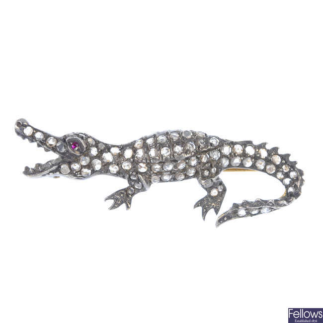 An early 20th century silver and gold ruby and diamond alligator brooch.