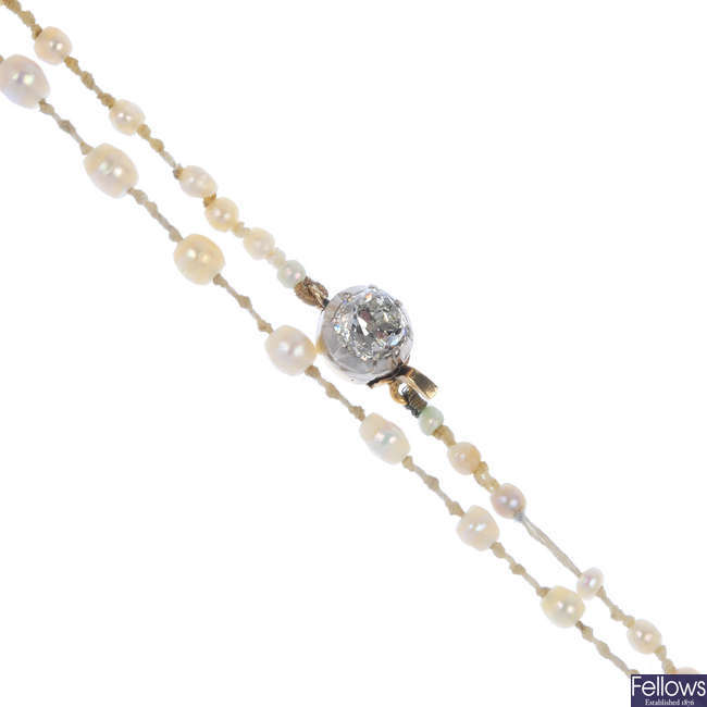 A pearl necklace with diamond clasp.