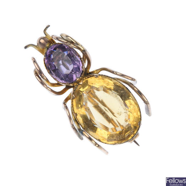 An early 20th century gold gem-set spider brooch.