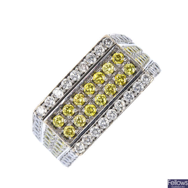 A 9ct gold diamond and colour treated diamond panel ring.