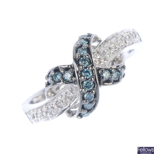 A colour treated diamond and diamond ring and earring set.