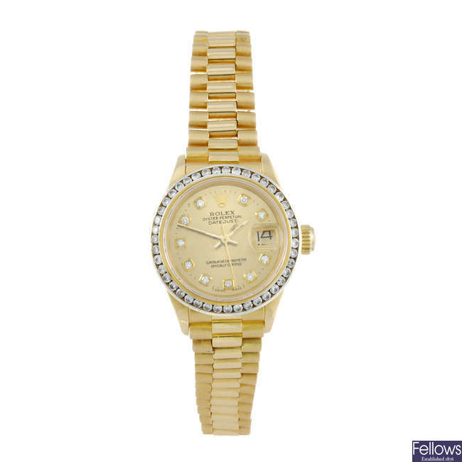 ROLEX - a lady's yellow metal Oyster Perpetual Datejust bracelet watch.