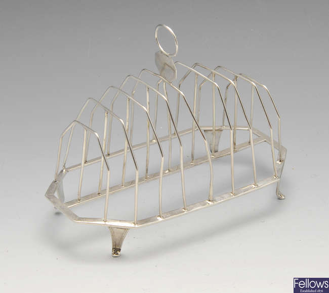 A George III silver eight-divide toast rack.