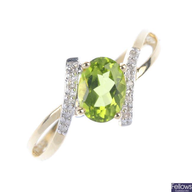 A 9ct gold peridot and diamond crossover ring.