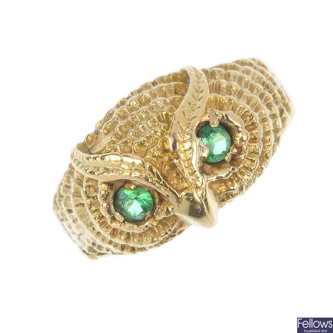 An emerald owl ring.