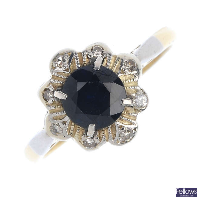 An early 20th century platinum and 18ct gold sapphire and diamond dress ring.