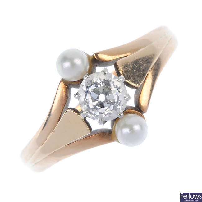 An early 20th century gold diamond and cultured pearl ring.