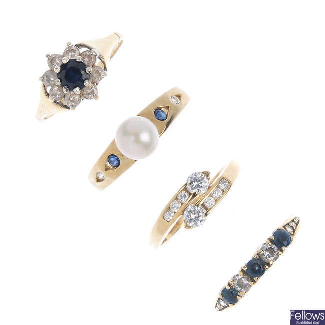 A selection of eight gem-set dress rings.