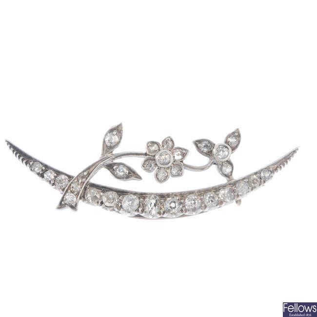 A diamond crescent brooch.