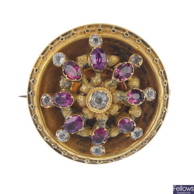 A late Victorian gold gem-set brooch.