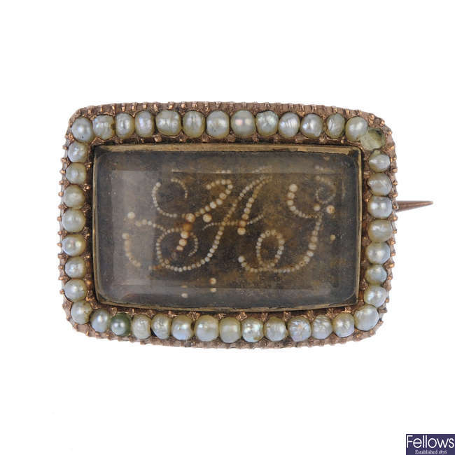 An early 19th century split pearl and hair memorial brooch.