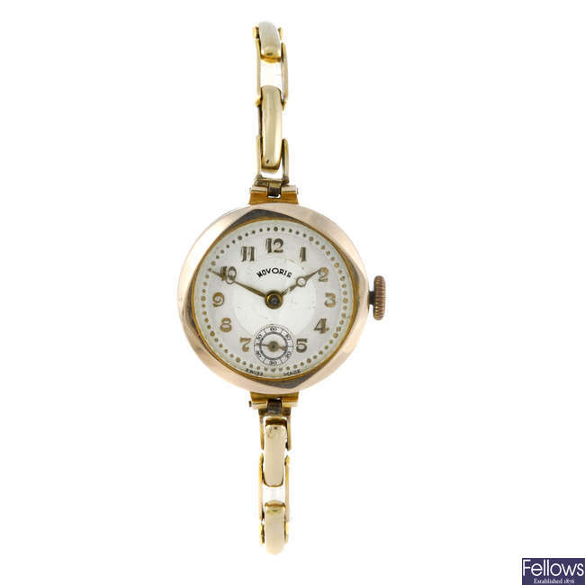 NOVORIS - a lady's 9ct yellow gold bracelet watch.