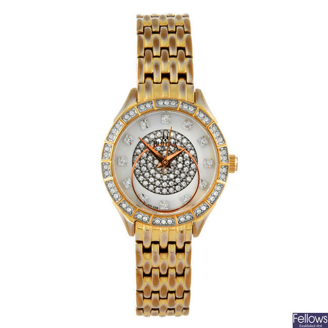 BULOVA - a lady's gold plated bracelet watch.