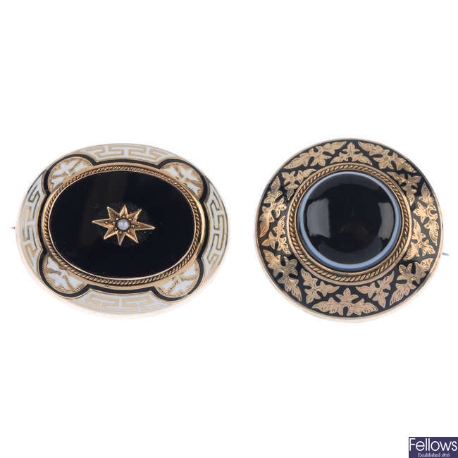 Two late Victorian gold and enamel mourning brooches.
