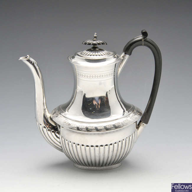 A Victorian silver coffee pot.