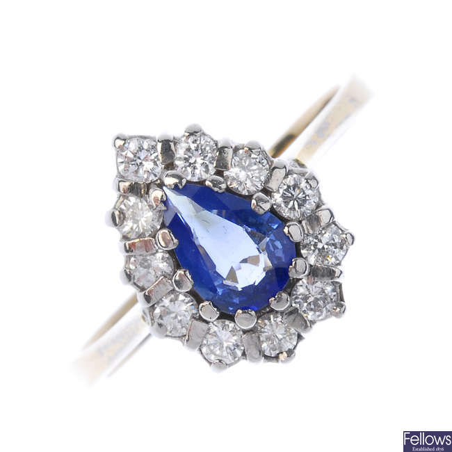 An 18ct gold sapphire diamond cluster ring.