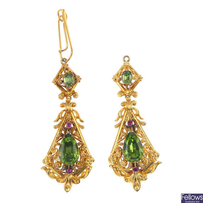 A pair of early 20th century gold peridot and ruby ear pendants.