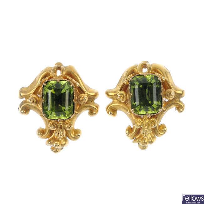 A pair of peridot ear studs.