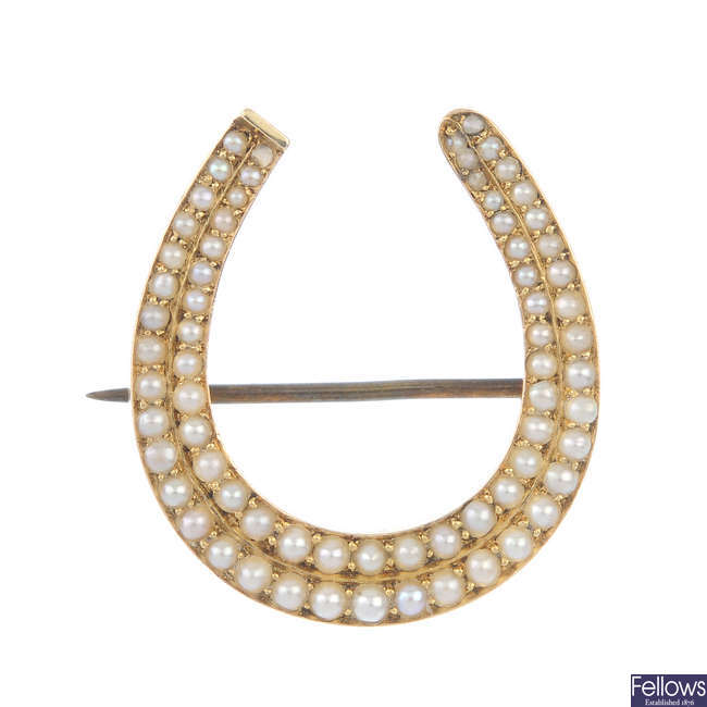 A late 19th century gold split pearl horseshoe brooch.