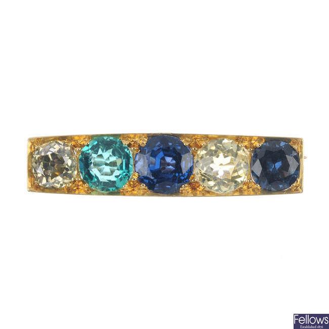 An early 20th century gold, diamond and gem-set bar brooch.