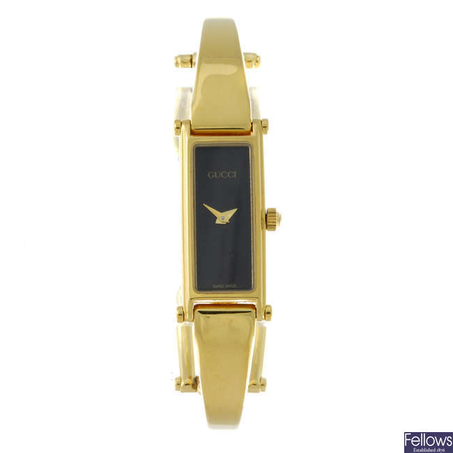 GUCCI - a lady's gold plated 1500 bracelet watch.