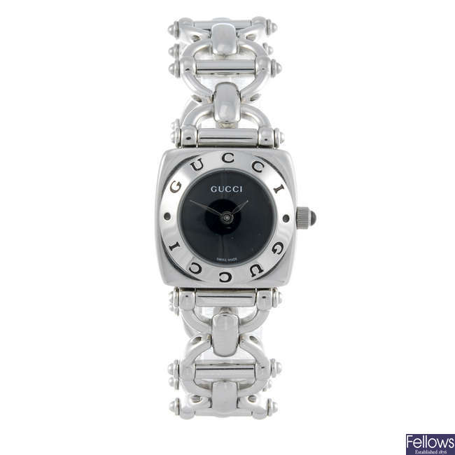 GUCCI - a lady's stainless steel 6400L bracelet watch.