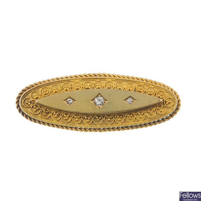 A late Victorian gold diamond brooch with memorial panel.