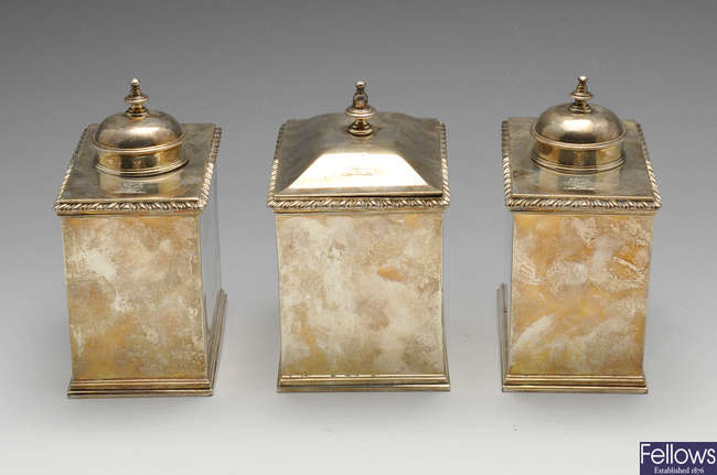 A set of three George III silver caddies.