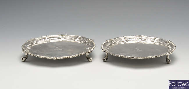 A matched pair of George III silver waiters.
